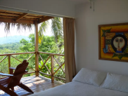 Each casita room has one Queen size bed, bathroom with shower and private deck with an ocean view.