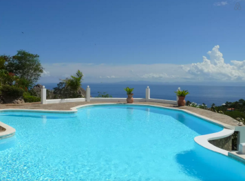 Great big pool with and ocean view